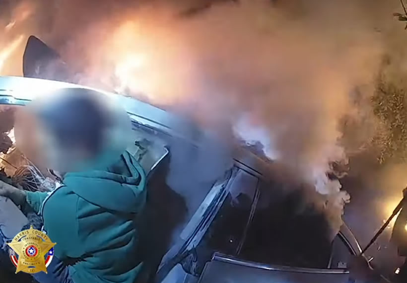 Dramatic police rescue saves man from a burning car moments before it