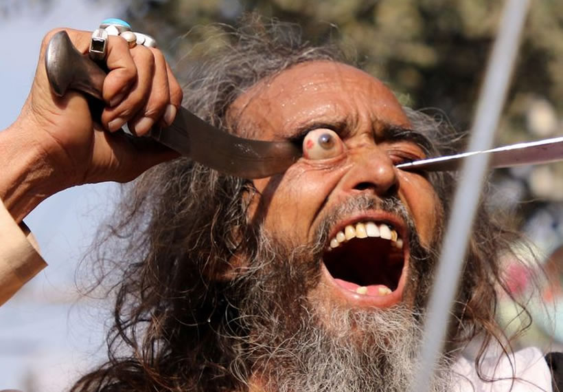 Worshippers use knives to pop their own eyes out in Indian religious festival
